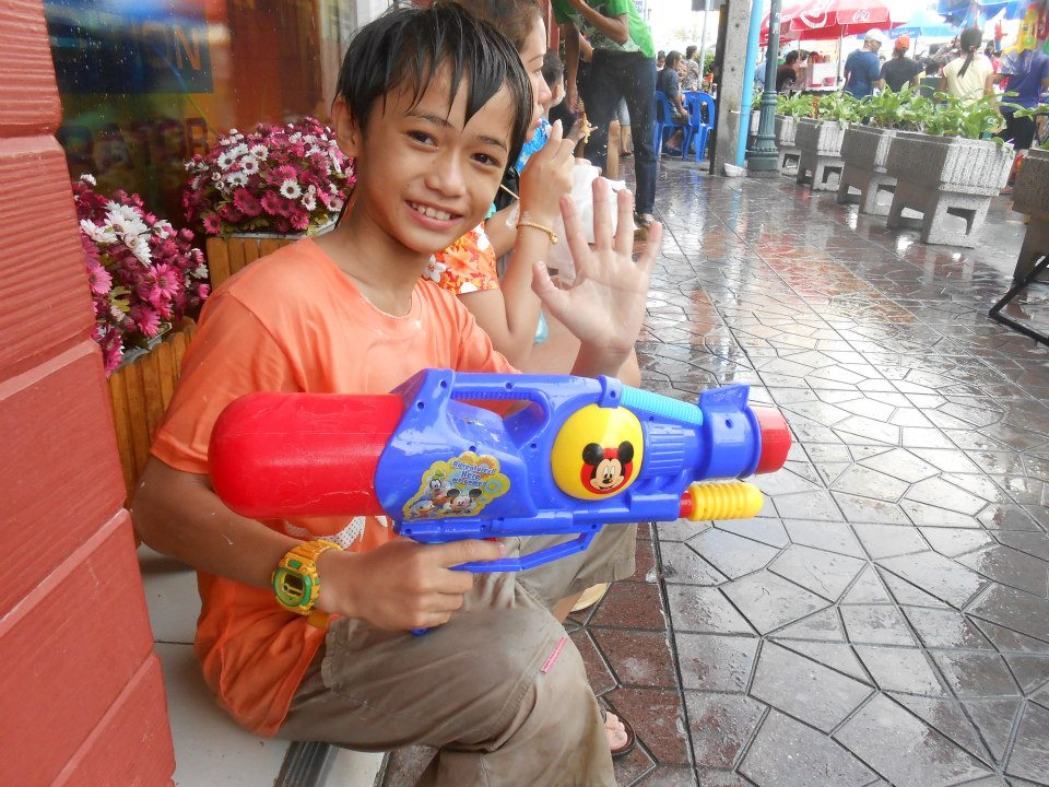 An adorable Thai boy with his massive super soaker!