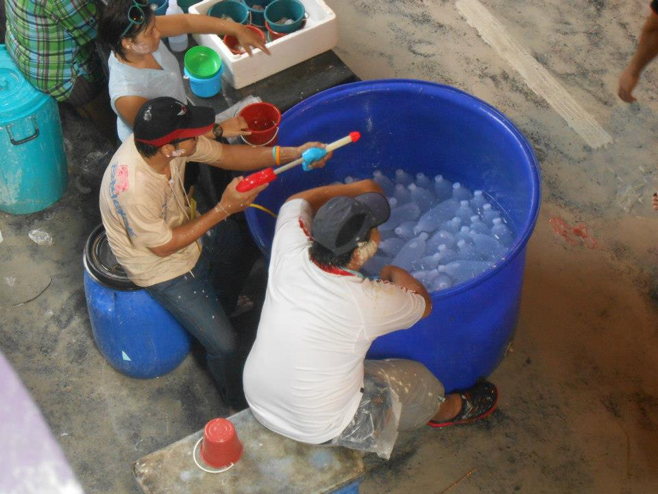 Thais selling extra water, and also preying on unsuspecting victims!